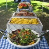 picnic buffet on blue gingham in oakland